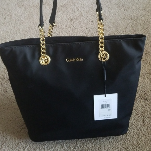 Calvin klein black and gold bag